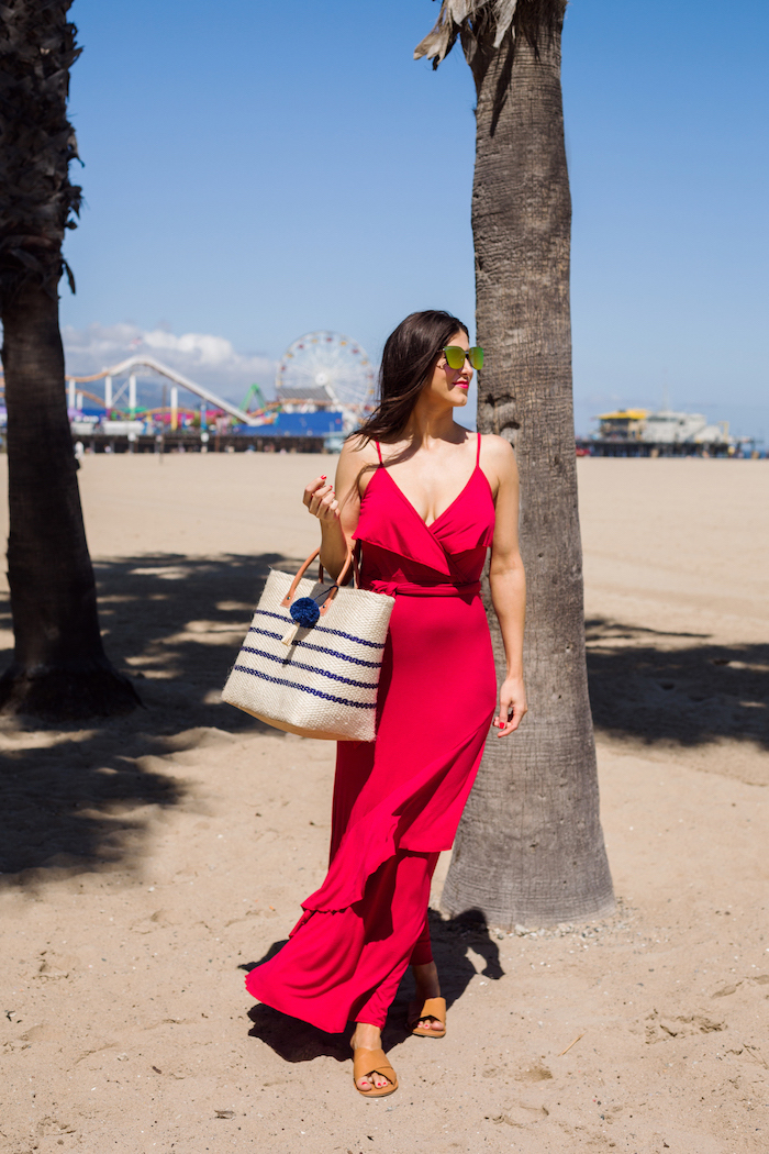 beach with park in the background white summer maxi dress woman on the beach wearing long red dress sunglasses