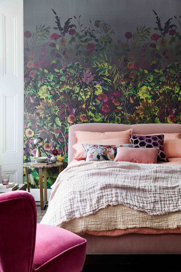 bed with pink velvet backboard lots of throw pillows cute room ideas floral wallpaper behind it pink velvet armchair