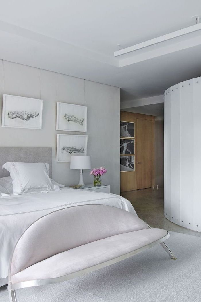 bedroom decor ideas all white bedroom walls curvy sofa black and white framed art hanging above the bed