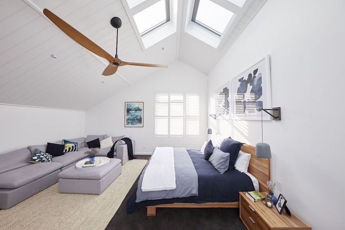 bedroom ideas for teenage guys with small rooms cathedral ceiling with windows large corner grey sofa wooden bed frame dark blue bed sheets
