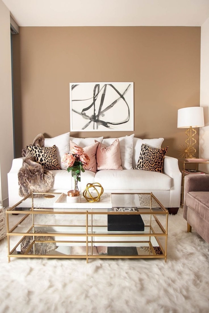 beige walls colors that go with grey white sofa with white and pink throw pillows with leopard print glass coffee table on white carpet