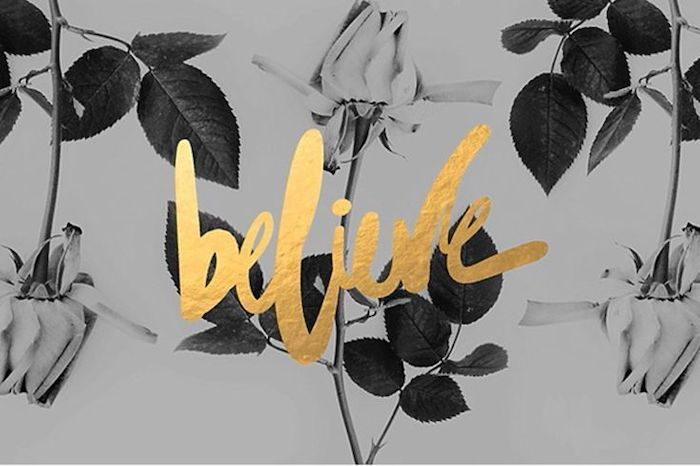believe written with gold letters on black and white background with roses cool wallpapers for girls