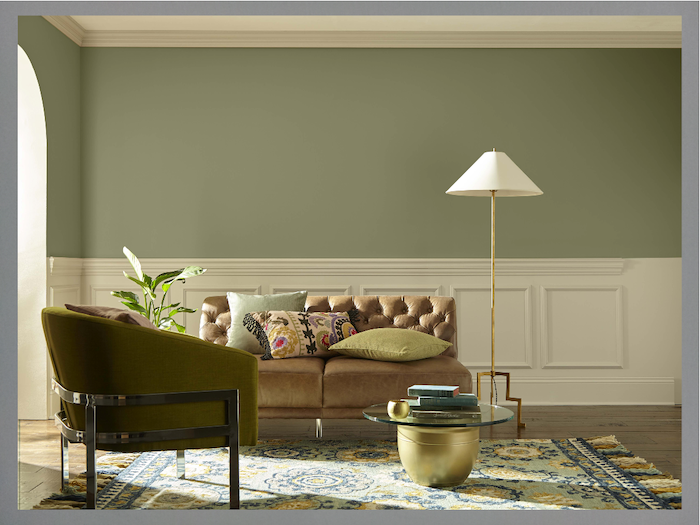 best living room paint colors green walls brown leather sofa green velvet armchair wooden floor
