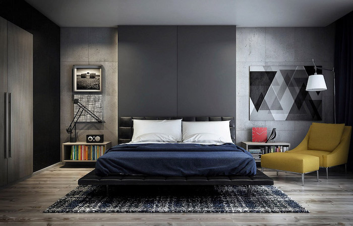 black accent wall behind bed with black leather bed frame bedroom wall decor ideas grey cement walls wooden floor with black and white carpet