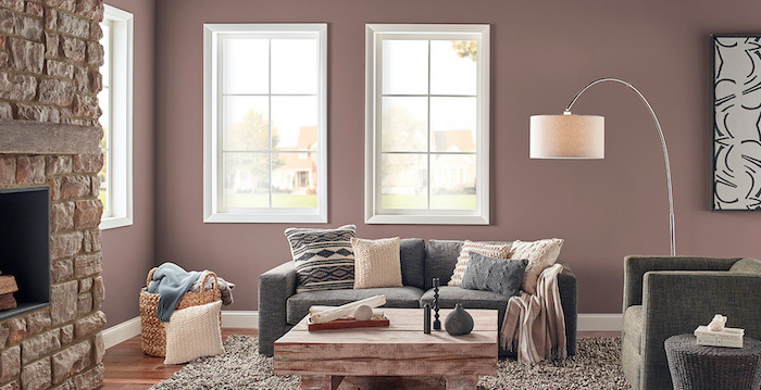 black and white wall art light pastel purple colors living room wall colors grey sofa armchair wooden coffee table in front of fireplace