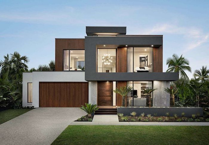 black and wooden facade of two storey house front yard landscaping ideas palm trees planted in front of it with grass