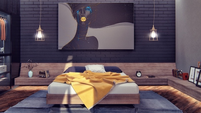 black brick wall with art above bed with yellow blanket dark blue pillows bedroom wall decor ideas floating wooden shelves with led lights wooden floor with blue carpet