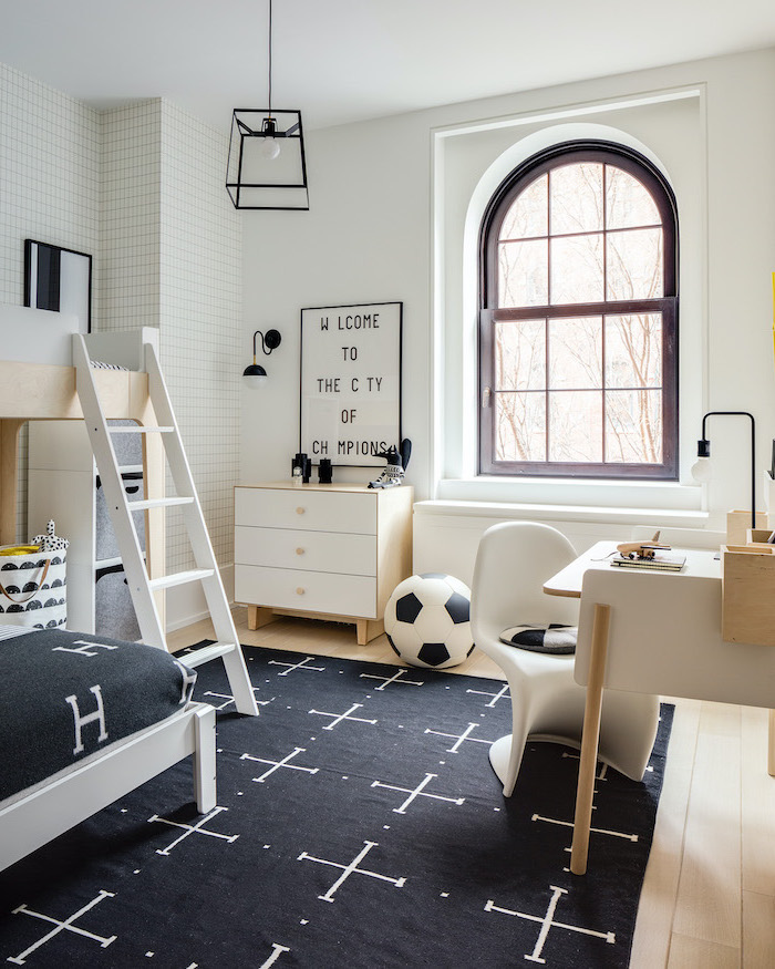 black carpet on wooden floor teen boy bedroom ideas white wooden desk night stand welcome to the city of champions sign on white wall