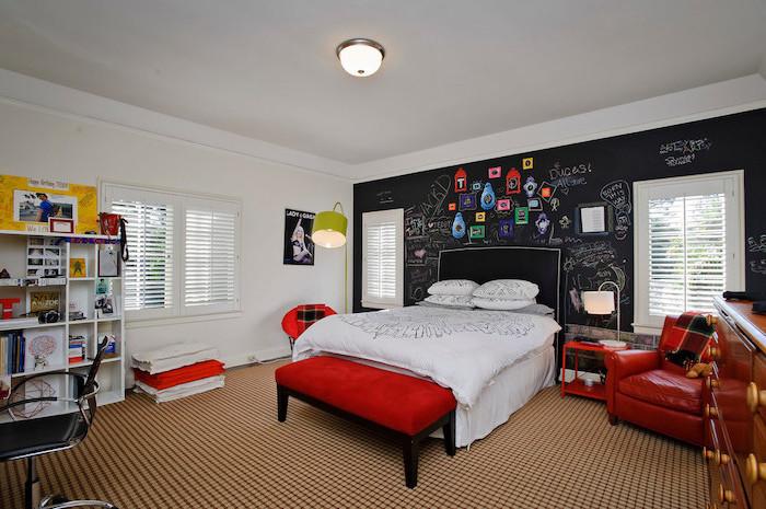black chalkboard behind the bed boys bedroom decor red orroman leather chair white bookshelf