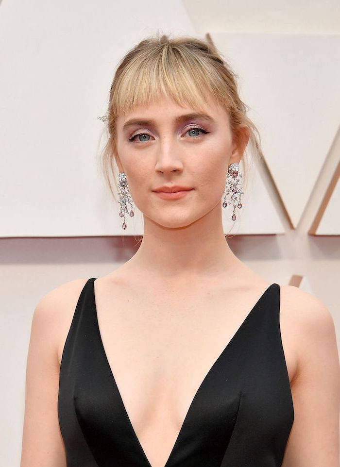 black dress worn by saoirse ronan on the red carpet haircut for thin hair to look thicker short bangs blonde hair in high updo
