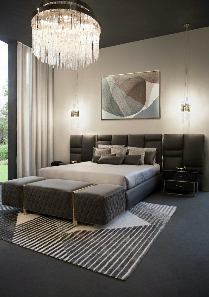 black leather bed frame black velvet ottoman in front of the bed master bedroom decor black floor with carpet