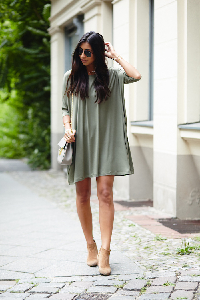 black long wavy hair on girl wearing olive green dress casual summer maxi dresses brown velvet boots white bag