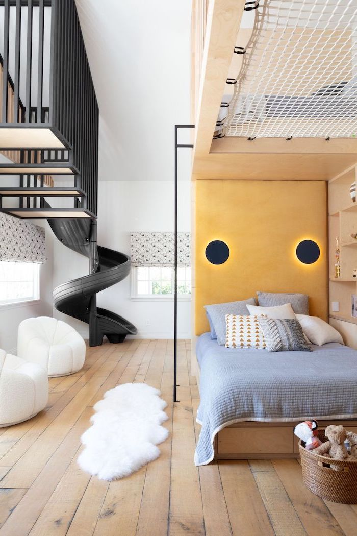black staircase with slide boys bedroom furniture wooden floor with two white armchairs wooden bed with bookshelves