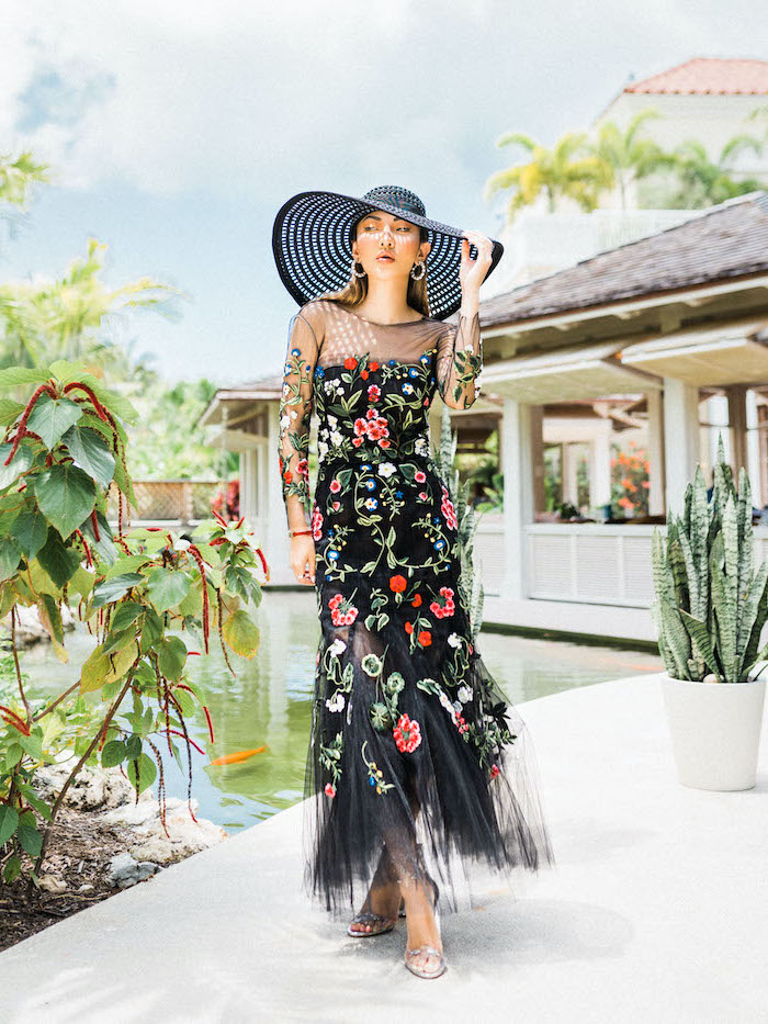 black tulle dress with flowers dresses to wear to a summer wedding black hat worn by blonde woman