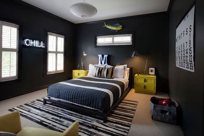 black walls chill neon sign green night stands on both sides of the bed boys bedroom decor black and white carpet