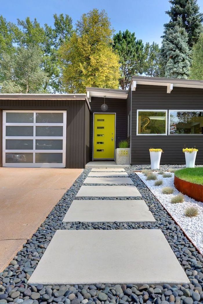 black wooden house landscaping ideas for front of house tiled pathway in gravel leading to neon green door