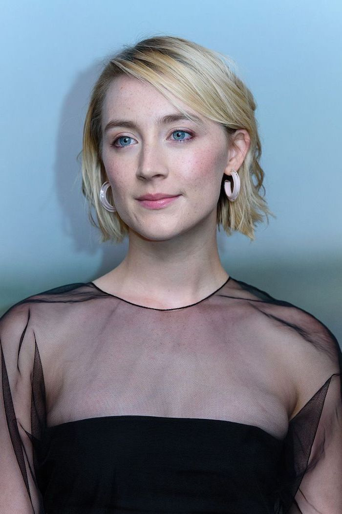 blonde wavy hair medium length hairstyles for thin hair saoirse ronan wearing black tulle dress standing in front of blue wall