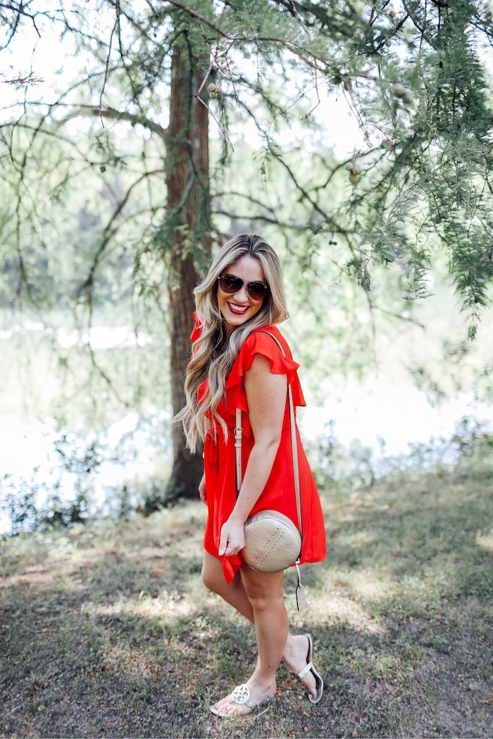 blonde woman wearing red dress cute summer dresses sunglasses beige leather crossbody bag