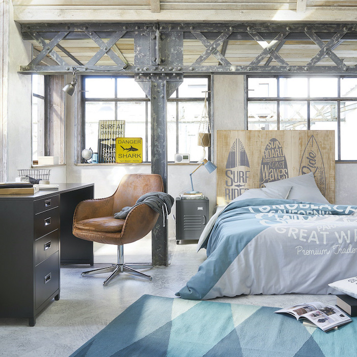blue bed sheets carpet in different shades of blue teen boy bedroom furniture black metal desk brown leather chair industrial decor