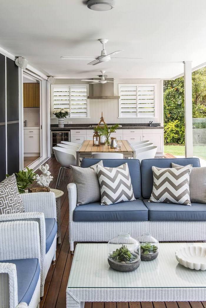 blue cushions on white garden furniture set on wooden floor stone patio ideas otdoor kitchen and dining area