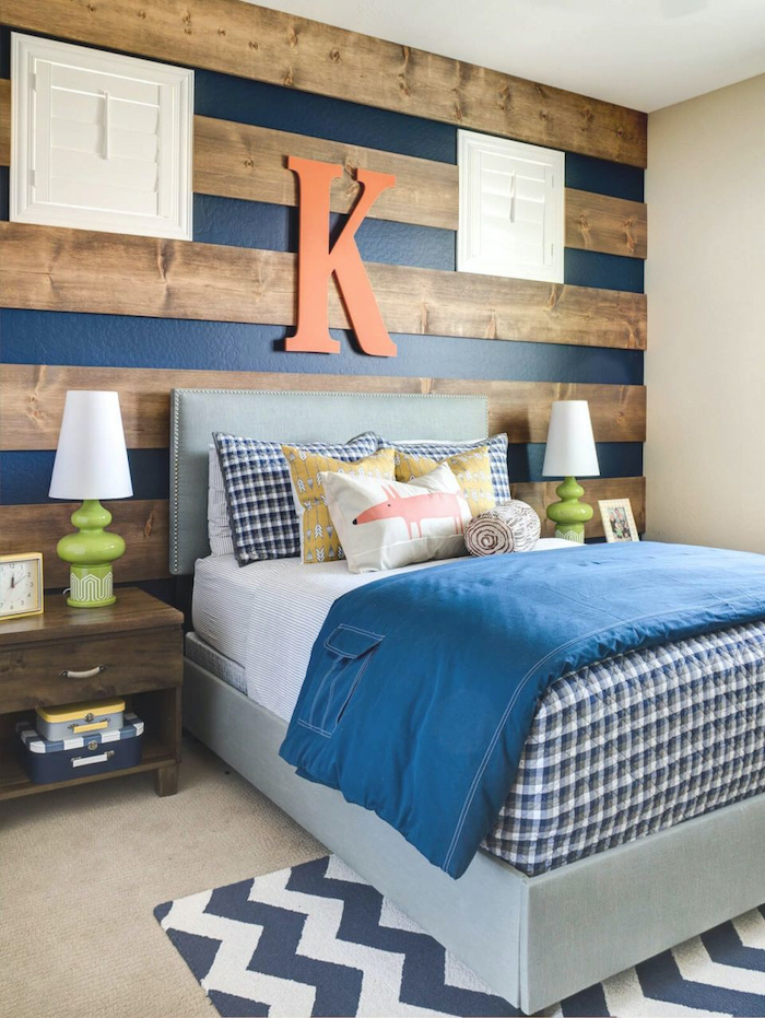 blue stripes wooden beams on the wall behind the bed bedroom ideas for teenage guys with small rooms orange letter k above the bed