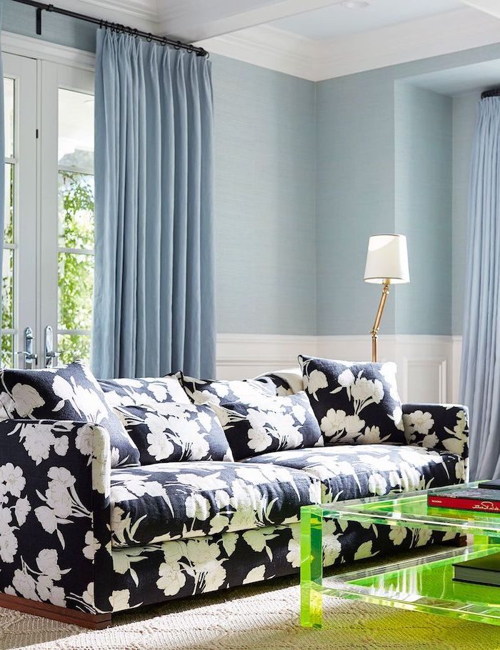 blue walls and curtains living room wall colors black sofa with white flowers print green glass coffee table