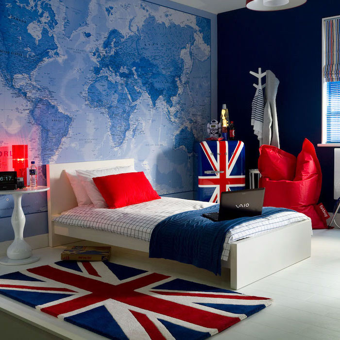 blue walls map of the world behind the bed bedroom ideas for teenage guys with small rooms united kingdom carpet theme red puff chair
