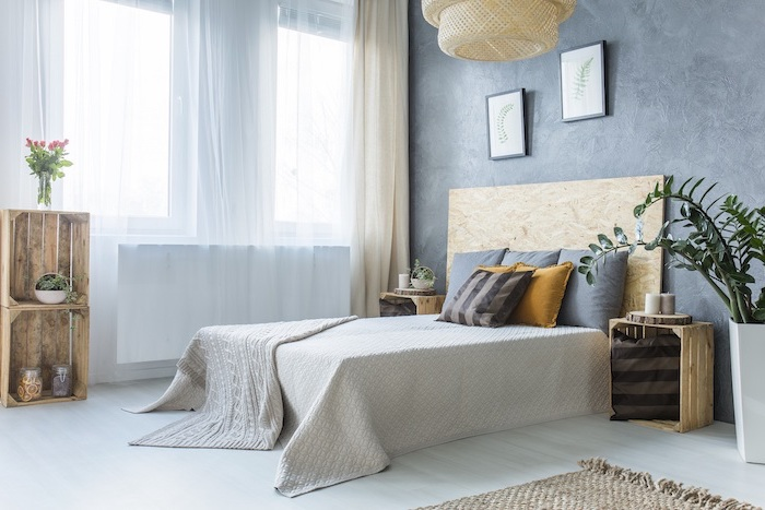 blue walls throw pillows modern bedroom ideas bed with wooden backboard light blue wooden floor crates for night stands