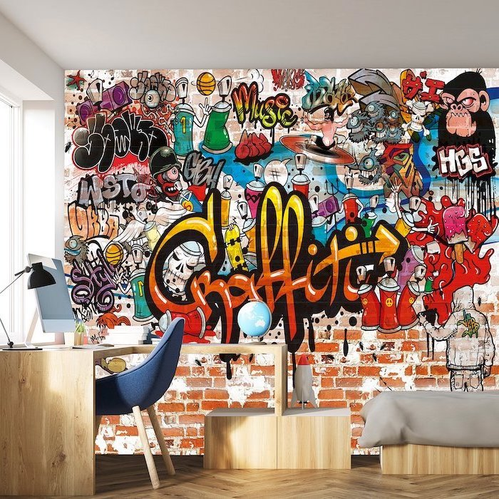 boys bedroom furniture wooden desk with blue chair wall filled with graffiti stickers behind them