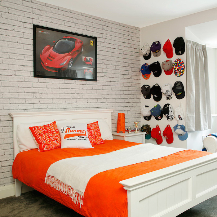 brick wall behind white wooden bef boys bedroom decor red ferrari poster collection of hats hanging on the wall