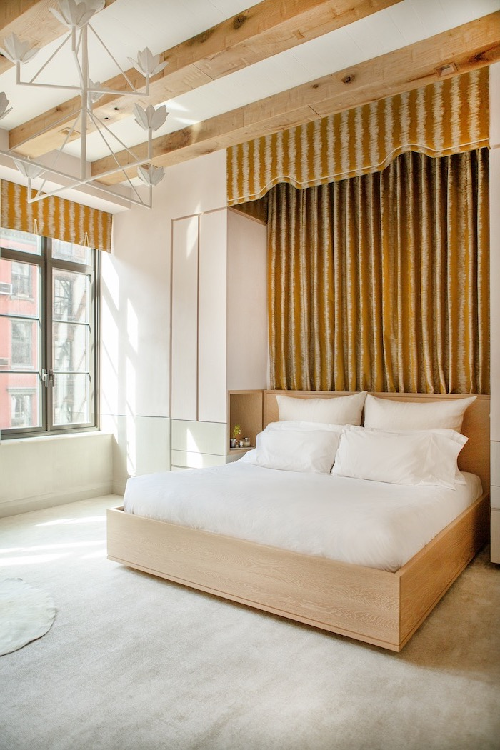 brown velvet curtains behin bed with wooden bed frame light grey carpet how to decorate a bedroom exposed wood beams on white ceiling