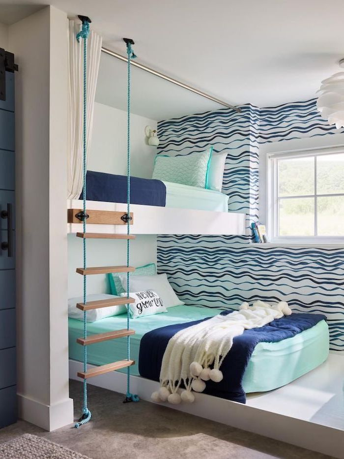 bunk beds with turquoise sheets pillows dark blue blankets ladder boys bedroom ideas blue waves on white walls