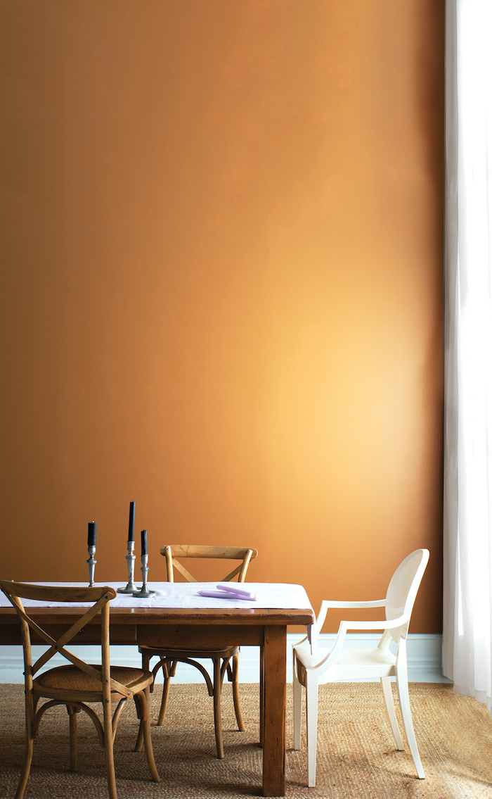 candles on wooden dining table with wooden chairs white table runnerliving room paint color ideas orange wall