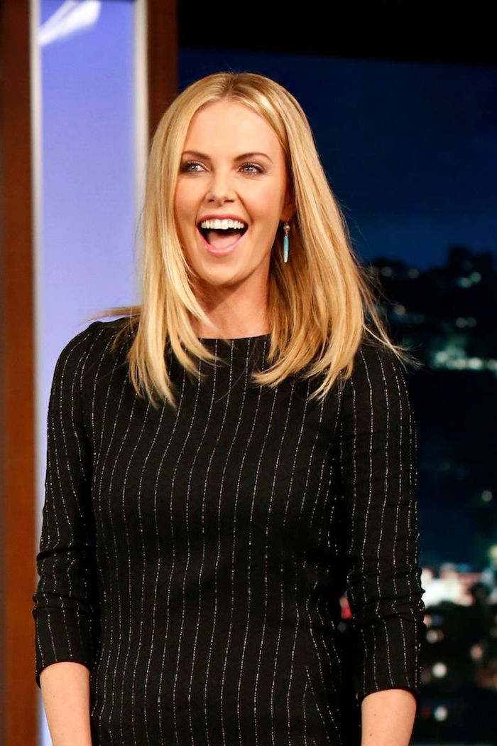 charlize theron with shoulder length straightened blonde hair haircuts for thin hair wearing black dress with long sleeves