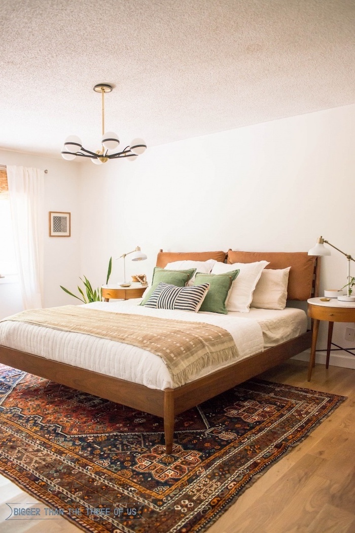 colorful carpet on wooden floor wooden bed frame white bed sheets brown green throw pillows how to decorate a bedroom
