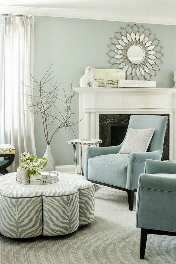 colors that go with grey light turquoise armchairs ottoman with zebra print in front of fireplace very light green walls