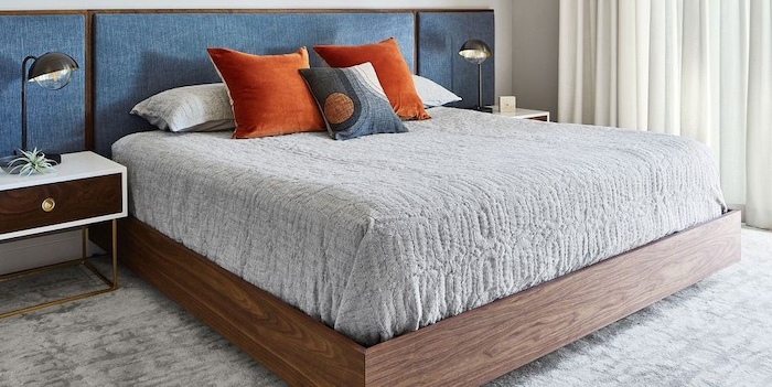 cute bedroom ideas blue backboard orange throw pillows on bed placed on light grey carpet two wooden night stands on both sides