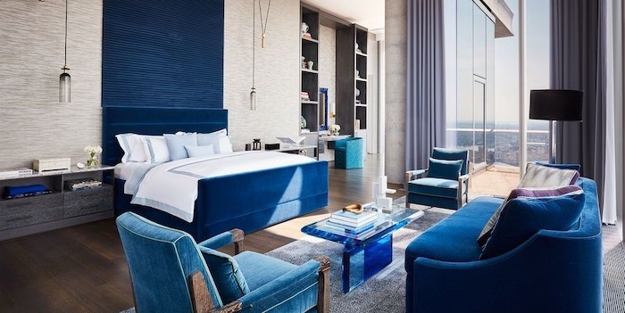 cute room ideas blue velvet sofa armchairs backboard bed large bedroom with wooden floor tall windows