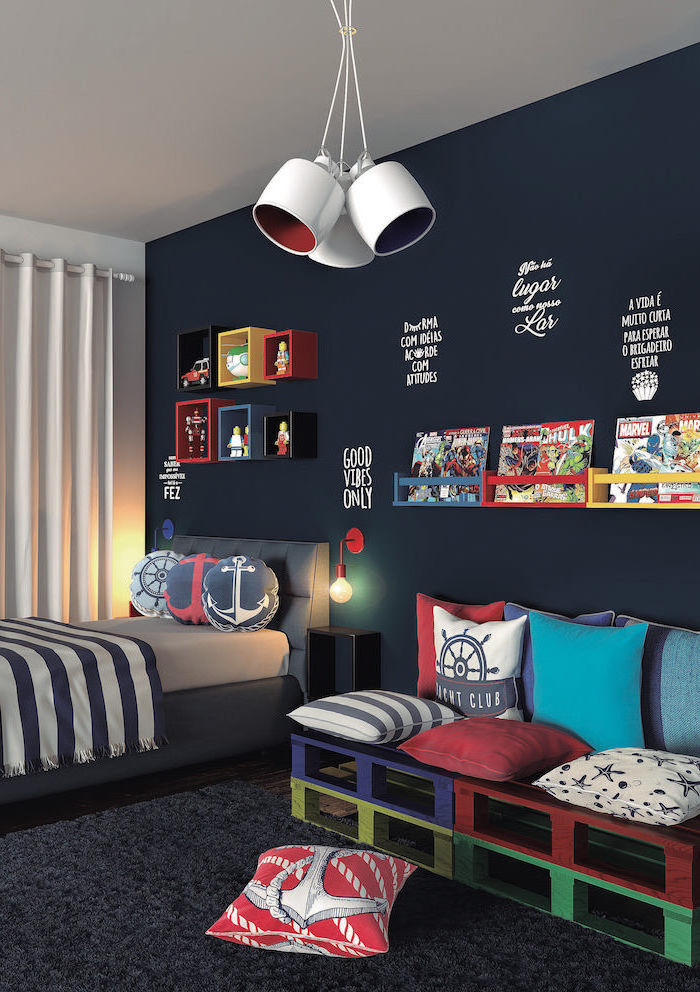 dark blue accent wall boys bedroom ideas maritime themed throw pillows small sofa made of pallets painted in blue red yellow green