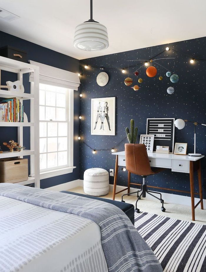 dark blue wall with stars led lights planets chandelier boys room paint ideas white wooden desk with brown leather chair
