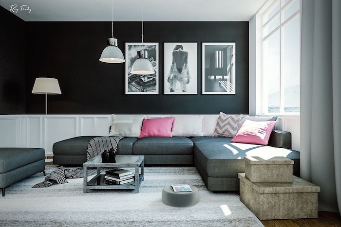 dark grey corner sofa with white and pink throw pillows living room paint colors black and white wall with black and white photo art white grey carpet on wooden floor