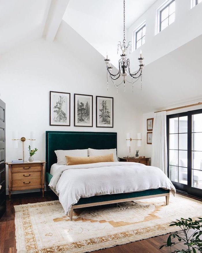 dark velvet green backboard on bed with white bed sheets master bedroom ideas cathedral ceiling wooden floor with carpet