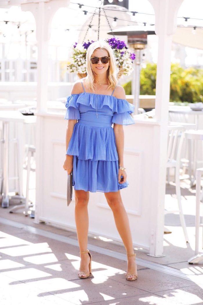 elegant dresses for wedding guests blonde woman wearing short blue dress nude sandals clutch bag sunglasses