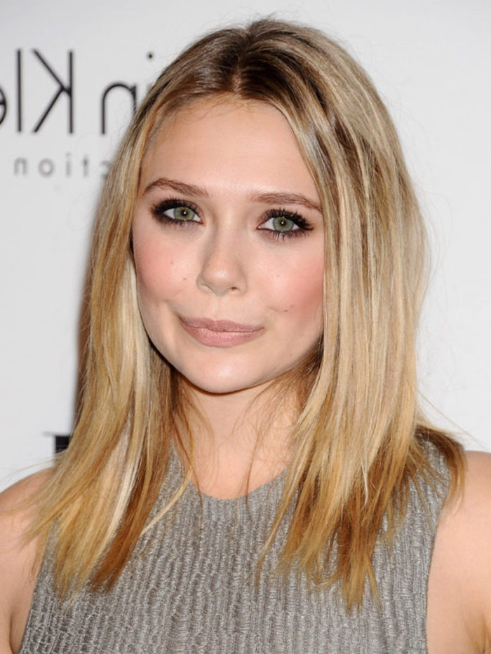 elizabeth olsen with blonde hair with highlights medium length hairstyles for thin hair wearing gray dress standing in front of white backdrop