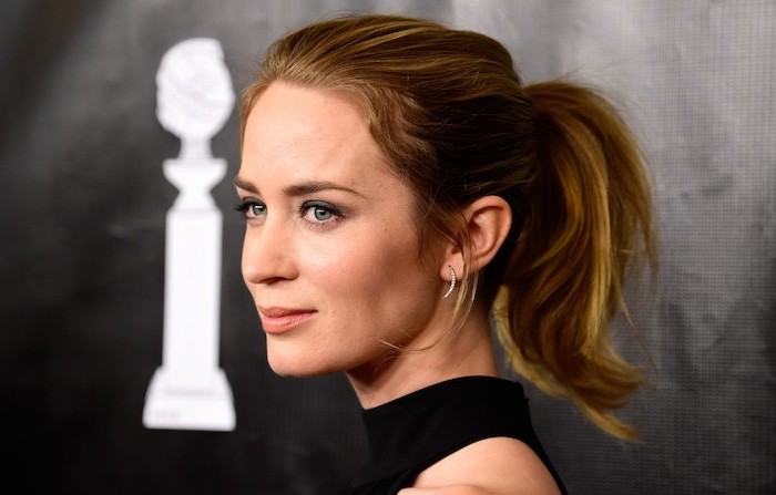 emily blunt with brunette hair with caramel highlights in ponytail haircut for thin hair to look thicker wearing black dress on the red carpet