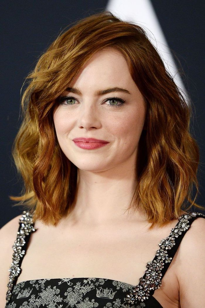 emma stone with red hair shoulder length curly side swept wearing black dress short haircuts for fine hair
