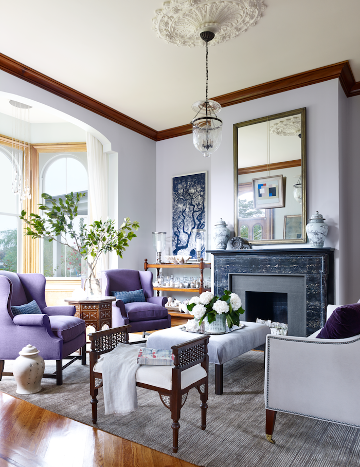 fireplace with black marble light purple walls colors that go with grey dark purple armchairs wooden floor