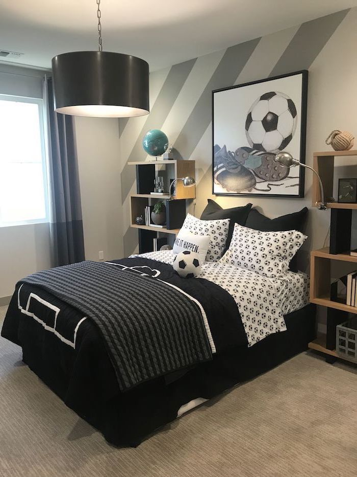 football inspired teen boy bedroom ideas black and white bed sheets two bookshelves on both sides of the bed framed drawing of football and shoes