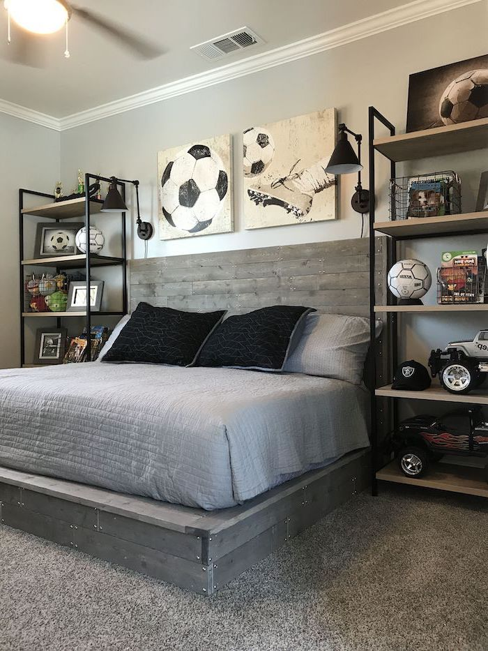 football themed room boys bedroom furniture football posters wooden pallet bed with grey sheets bookshelves on both sides