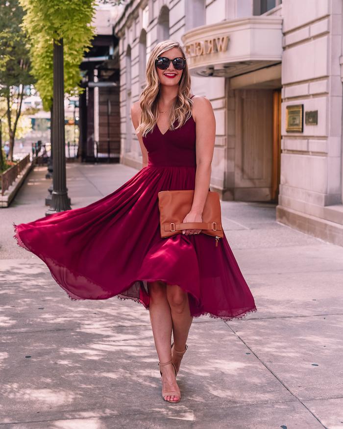 formal dresses for weddings blonde woman wering midi burgundy dress nude sandals brown leather bag